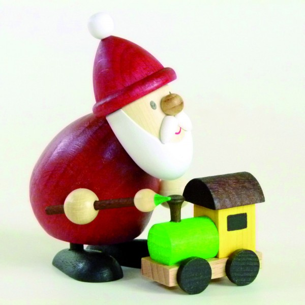 Santa Claus with paintbrush and train